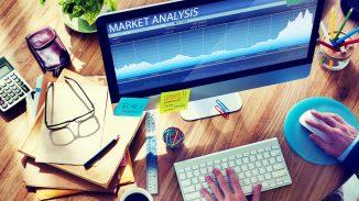 Man Working On A Market Analysis Document