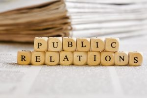 Concept of dices with letters forming words: Public Relations