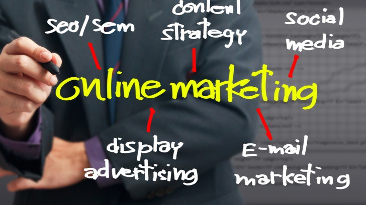 Man writing the online marketing information