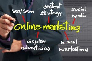 Businessman pointing at Online Marketing