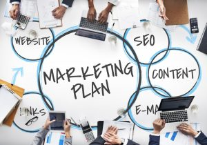 a diagram of marketing plan with people working around it