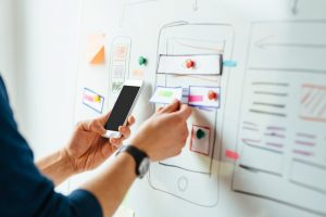 Person designing mobile app interface