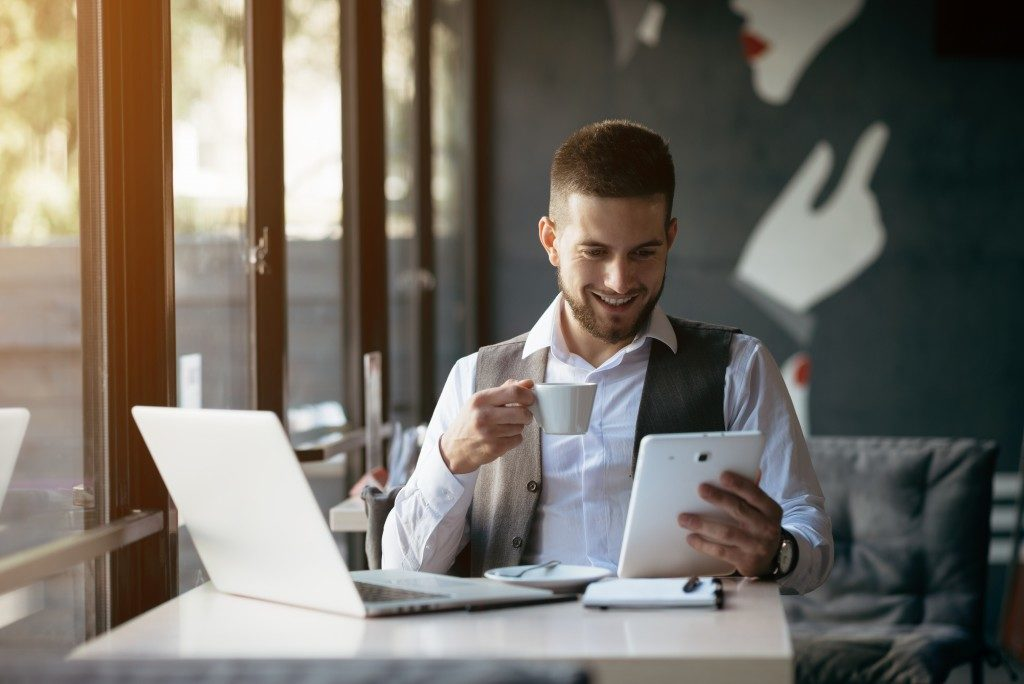 Businessman using tablet and laptop