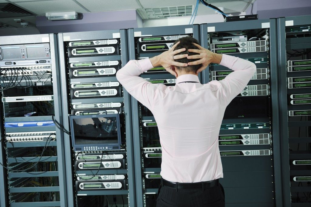 Frustrated employee in the server room