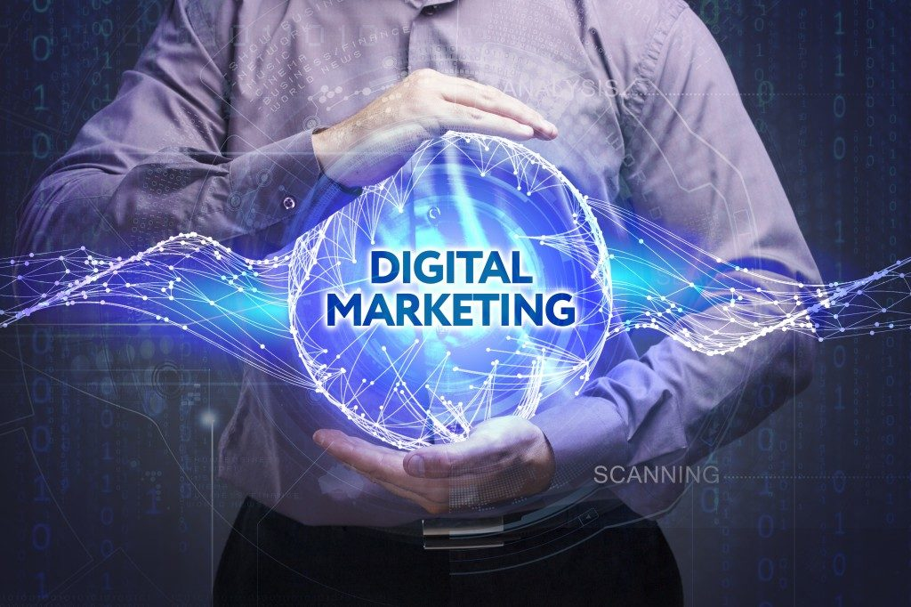 man holding a digital marketing sphere
