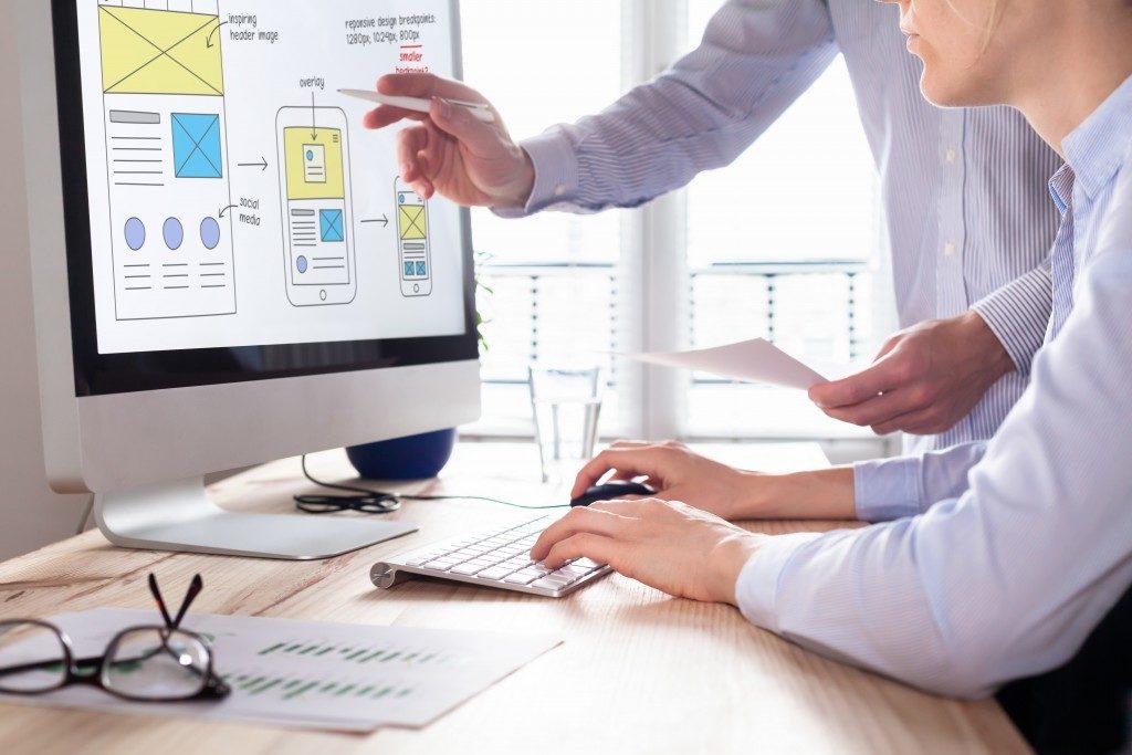website designer with his boss